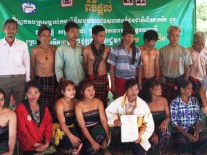 Pu Trom's community members with their collective land title