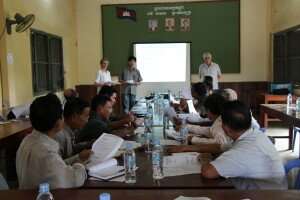 Marion Kütemeyer and Christian Weiser - assisted by an interpreter - discussing the role of city councils in local economic development with members of the Sangke District Council.
