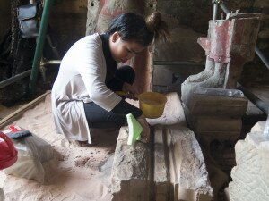Cleaning of fragments of 12th century buddha statues - Prasat pre Rup