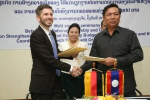 Daniel Blessing, GIZ Advisor to the ASEANSAI project, and Mr. Khampoun Phengthirath, Deputy Director General, Department of Planning and Finance, National Assembly of Lao PDR, exchange the signed cooperation agreement in Vientiane, Lao PDR
