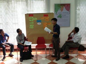 Participant presenting about challenges and opportunities of Vietnam's SMEs in ASEAN Economic Community