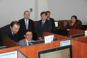 Representatives from Azerbaijan's CSC and Cambodia's MCS test and discuss the computer-based civil service entrance exam in one of Azerbaijan's examination centers.