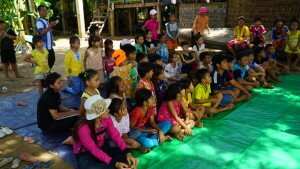 Ethnic Vietnamese children are engaged in discussing alternative solutions to interethnic conflict