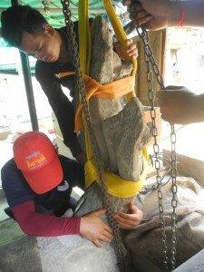 Re-attachment of Naga Head to ballustrade - Prasat Banteay Samre