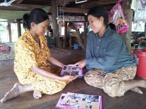 © UNICEF Cambodia/2014/Navy Kieng Mrs. Sophy with a pregnant woman in her village.