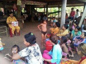 © UNICEF Cambodia/2014/Navy Kieng Mrs. Sophy, the village health volunteer, explains pregnancy to women in her village.