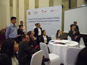 The author (middle) sitting with workshop participants discussing indicators for the ASEANSAI Strategic Plan.