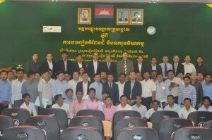 Group photo of the training participants with H.E. the Senior Minister